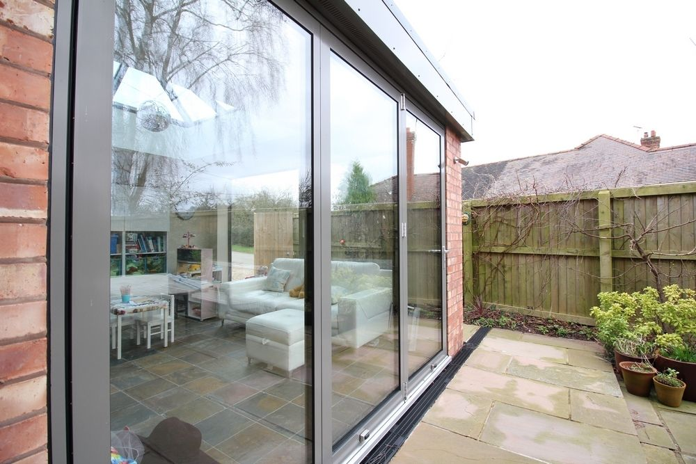 External shot of bi-fold doors in Bunbury, Cheshire.  Doors supplied by our partner company John Knight Glass.