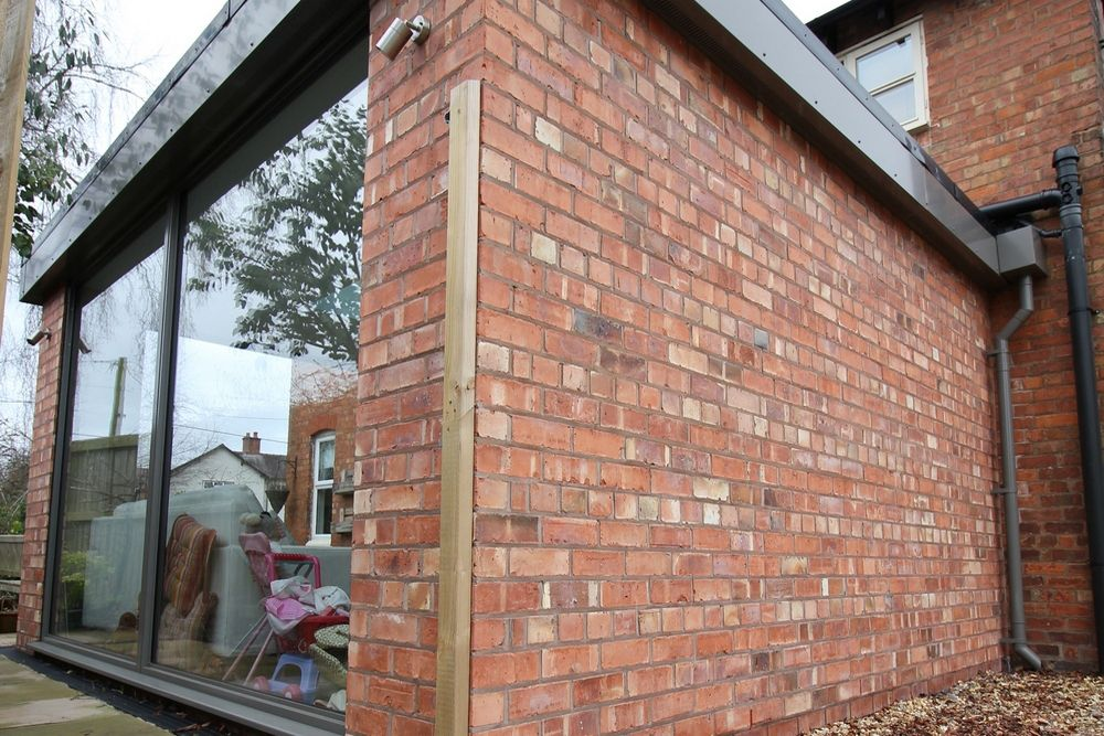 External shot showing traditional brick detail that links the new orangery build with the traditional farmhouse.
