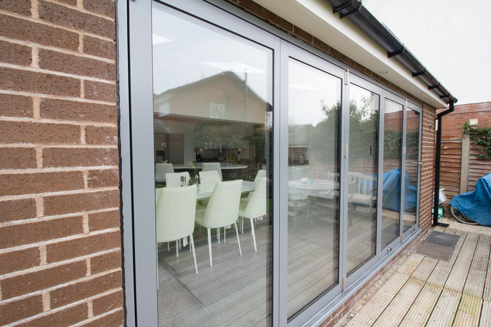 RAL colour coded bi-fold doors supplied and fitted by our partner company John Knight Glass.