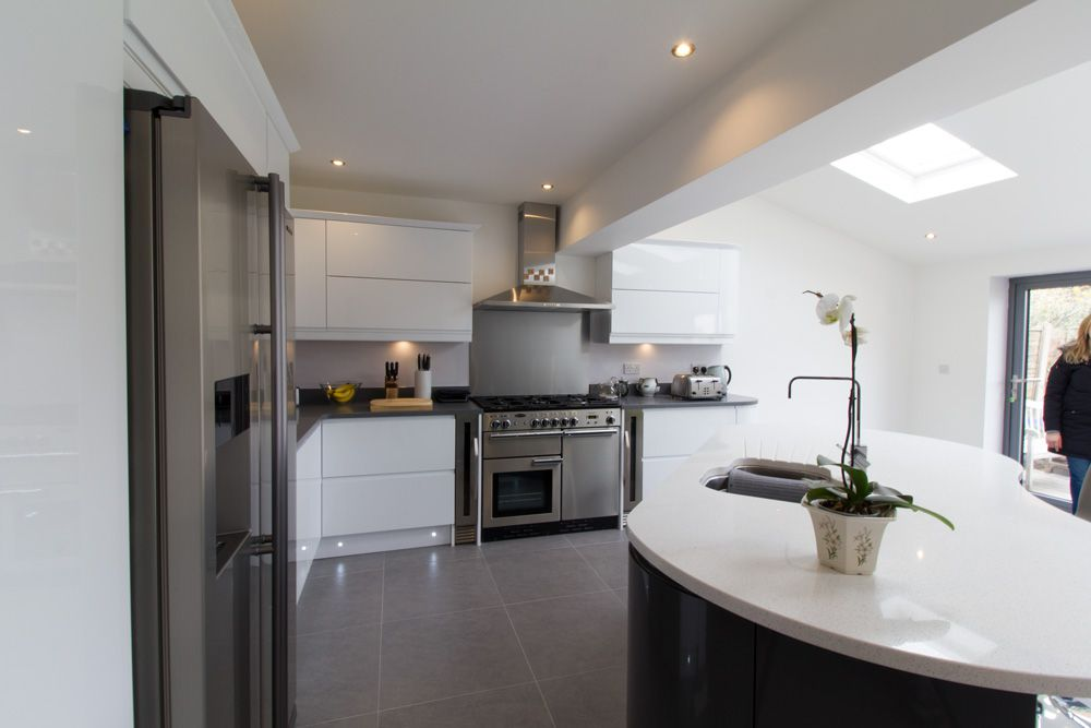 Internal shot of modern kitchen supplied and fitted by OPB, featured include: gloss 18mm cabinets, Quartz worktops and stainless steel appliances.
