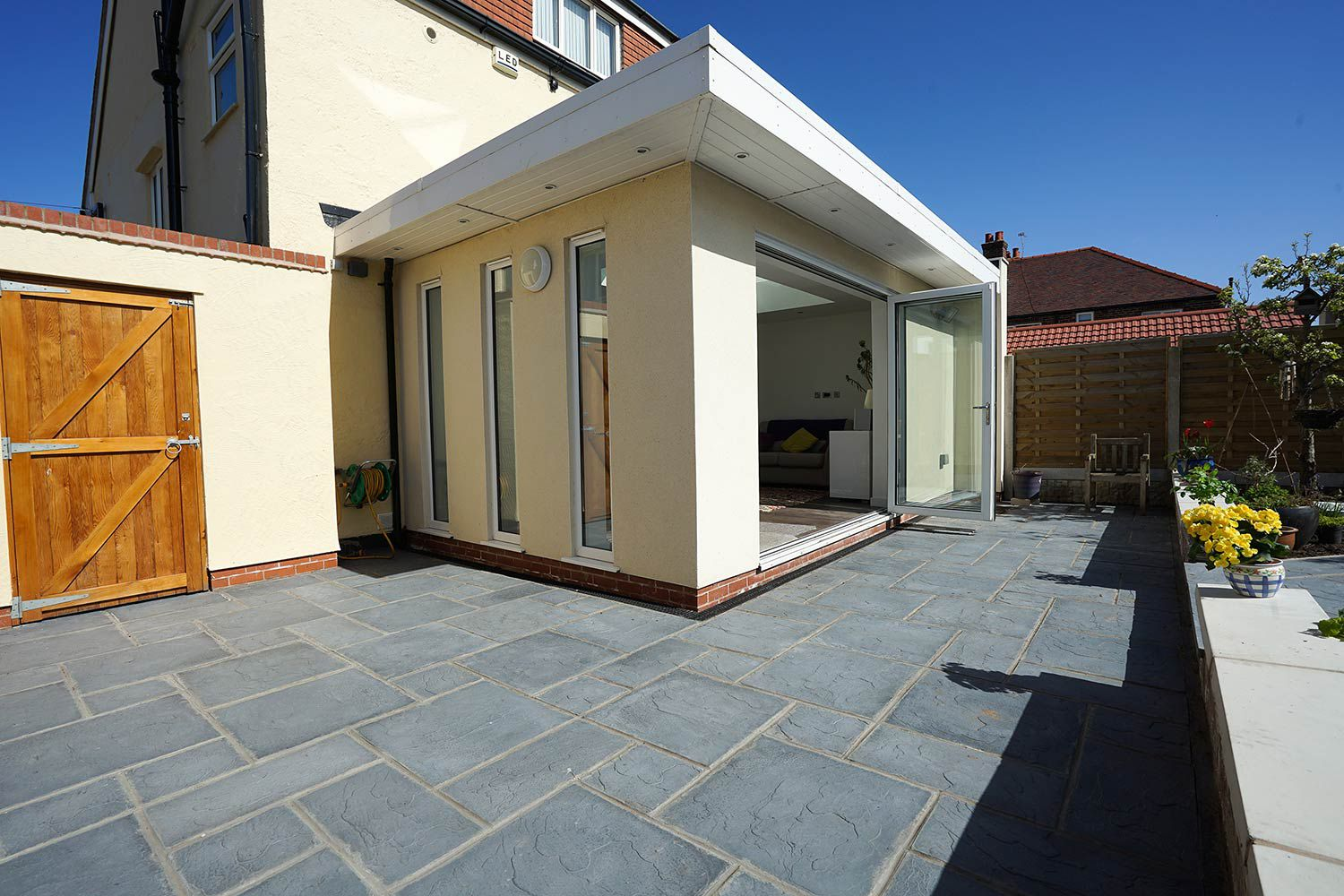 Modern orangery extension in Hoylake, Wirral.  Completed by Wirral builder OPB featuring a structural alteration to the existing kitchen to create an open plan kitchen / dining / living space to the downstairs of the property.