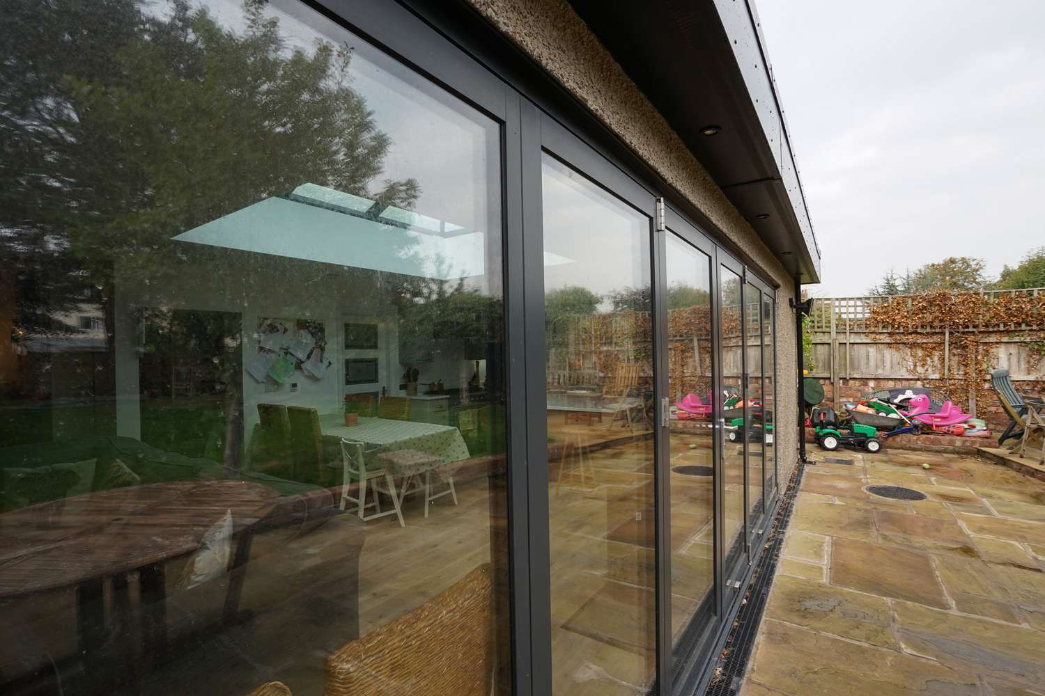 Close up of large aluminium bifold doors to create the perfect flow between the indoor and outdoor living space.