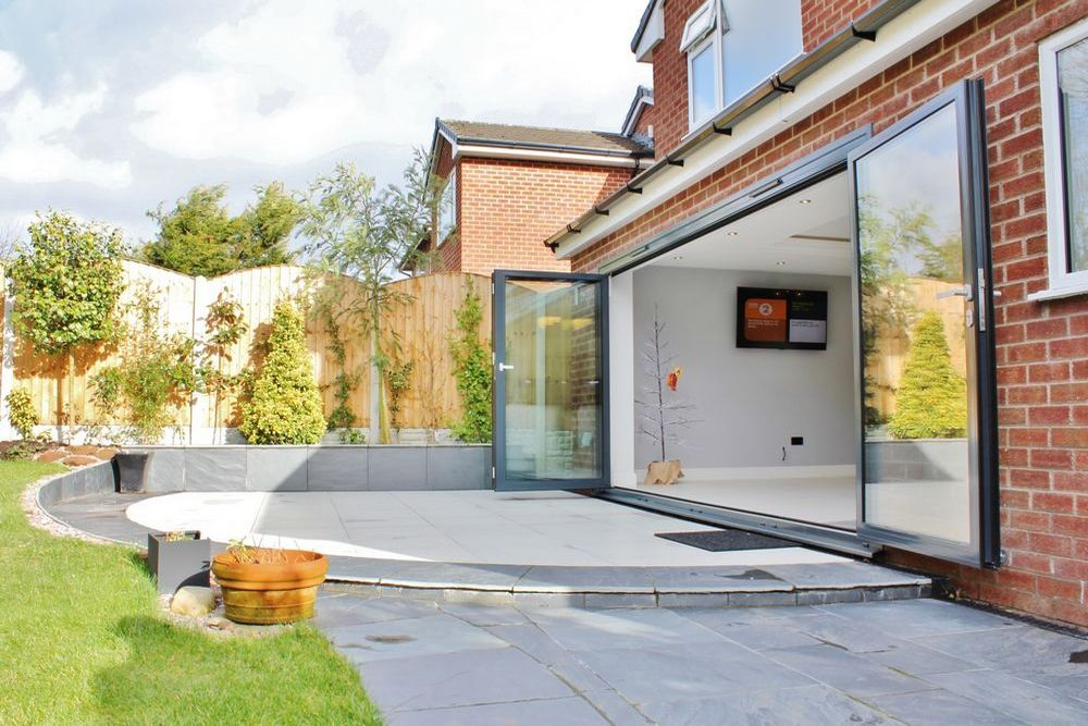 External shot of double story extension by Wirral builder OPB showing hard landscaping to compliment the rear extension.