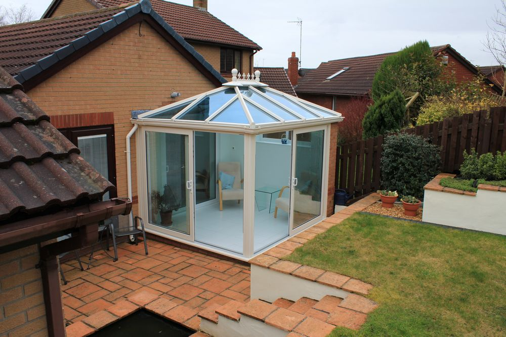 Garden room in collaboration with John Knight Glass, complete with tinted windows and underfloor heating.