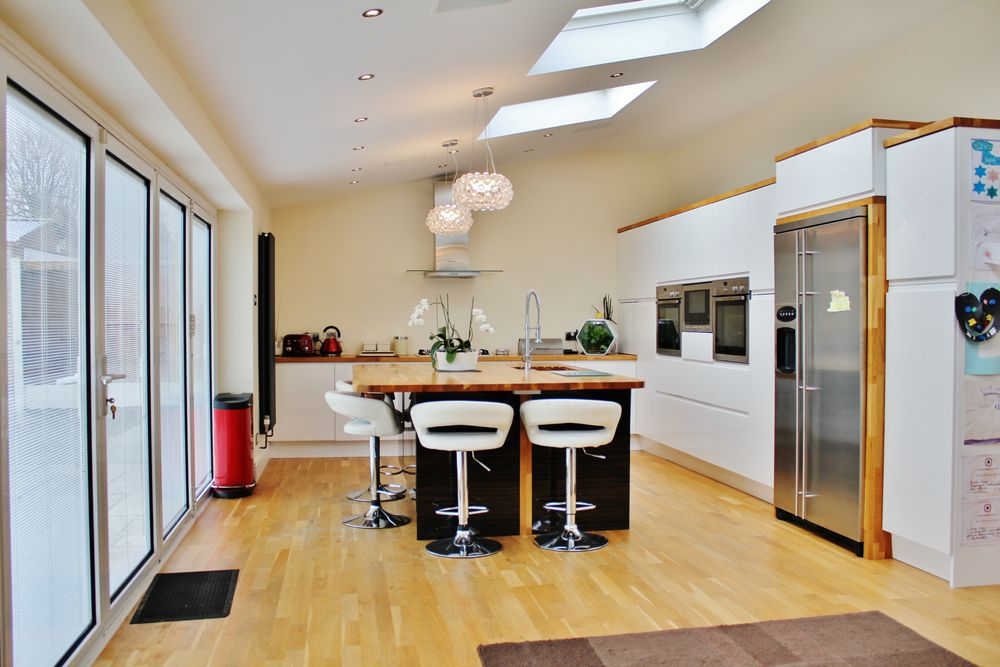 Kitchen extension in Wirral with modern kitchen and large bi-fold doors, by Wirral Builder OPB.