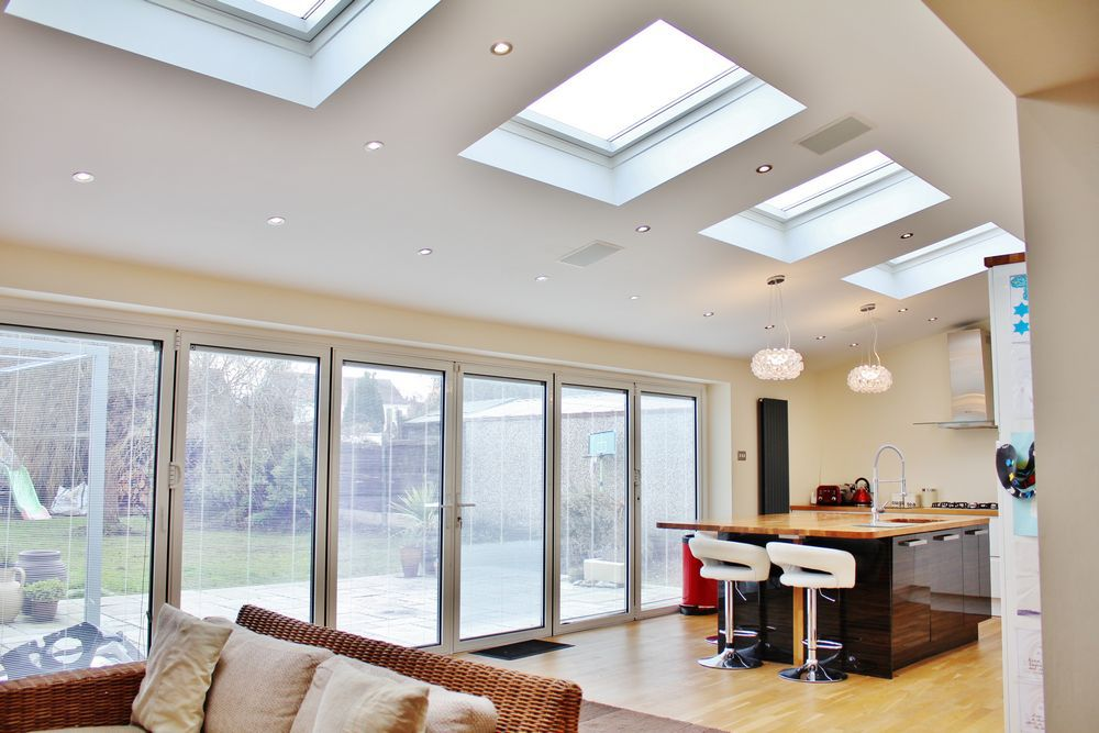 Velux roof lights installed in Pensby, Wirral to create a light modern feel to this open plan kitchen extension.