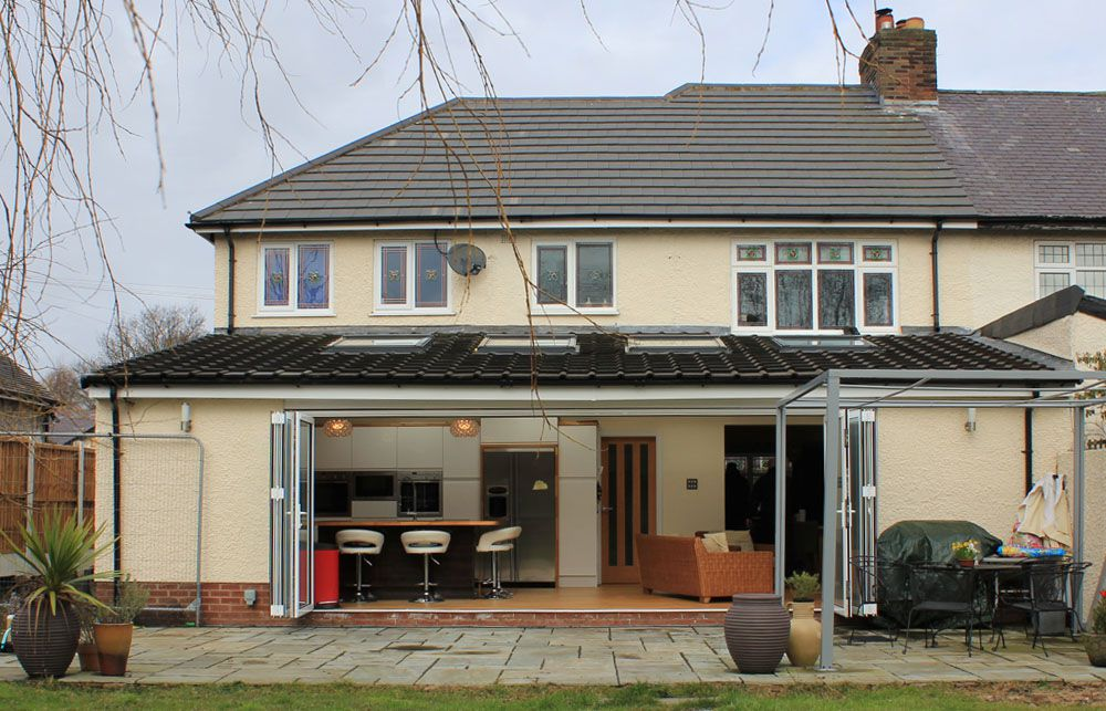 Rear view of double story extension with large open plan kitchen extension in Pensby, Wirral.