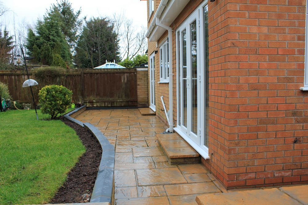 Exteneal hard landscaping completed with large patio and garden walling.